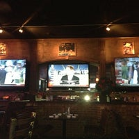 Photo taken at Devines Restaurant & Sports Bar by mike s. on 12/18/2012