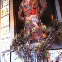 Photo taken at Full Circle Tattoo by Kay C. on 12/22/2012