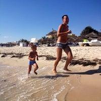 Photo taken at Soussa beach by Тихон Б. on 8/1/2013