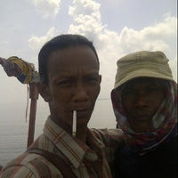 Photo taken at Dampo Awang Beach by Deddy A. on 3/2/2014