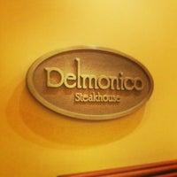 Photo taken at Delmonico Steakhouse by Ernie A. on 4/12/2013