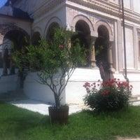 Photo taken at Mânăstirea Bistrița by Marian C. on 5/17/2014