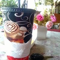 Photo taken at ร้านกาแฟนั่งเล่น by Phimphicha S. on 1/1/2014