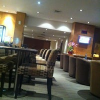 Photo taken at PURA INDAH First & Business Class Lounge by Thomas G. on 11/10/2012