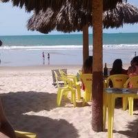 Photo taken at Praia de Iracema by Márcyah D. on 5/31/2014