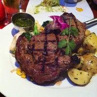 Photo taken at Mixto Restaurant by Matthew M. on 4/15/2012