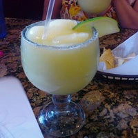 Photo taken at Tink-A-Taco Mexican Food & Cantina by Destiny B. on 4/6/2012