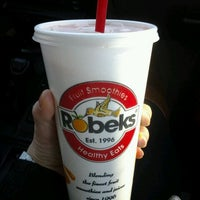 Photo taken at Robeks Fresh Juices & Smoothies by Jenna R. on 2/15/2012