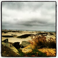 Photo taken at Coronado Beach by julian c. on 6/12/2012