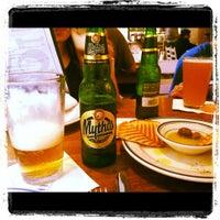 Photo taken at Village Taverna by Jenn G. on 7/21/2012