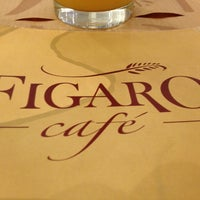 Photo taken at Figaro Café by Marcio K. on 6/17/2012