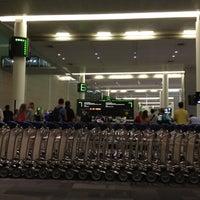 Photo taken at Baggage Claim by Richard J. on 3/18/2012