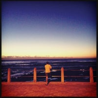 Photo taken at Sea Point Beach Promenade by Lisa W. on 3/5/2012