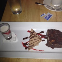 Photo taken at Fin Restaurant & Raw Bar by Lyzeth S. on 7/25/2012