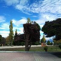 Photo taken at Plaza de Armas de Puerto Natales by Felipe V. on 3/8/2012