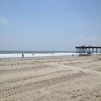 Photo taken at 13th St. Beach by Elizabeth B. on 5/31/2012