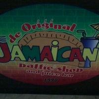 Photo taken at De Original Jamaican Pattie Shop by Mai D. on 5/30/2012