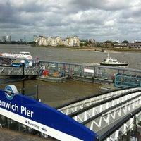 Photo taken at Greenwich Pier by Emir on 8/2/2012
