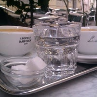 Photo taken at Café Hawelka by Kürşat E. on 6/2/2012