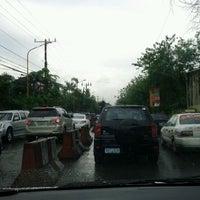 Photo taken at Ortigas & Greenmeadows Avenue Intersection by Myn on 2/13/2012