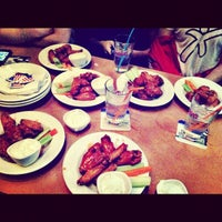 Photo taken at Boston's Restaurant & Sports Bar by Angel O. on 6/1/2012