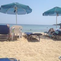 Photo taken at Totos Beach Bar by Kiki T. on 7/7/2012