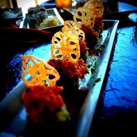 Photo taken at RA Sushi by Aric H. on 4/19/2012