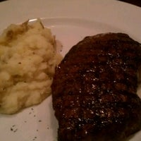 Photo taken at Firebirds Wood Fired Grill by Shantel H. on 4/21/2012