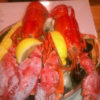 Photo taken at Popei's Clam Bar & Seafood Restaurant by Tom M. on 4/26/2012