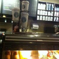 Photo taken at Starbucks by KarLita C. on 7/23/2012