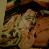 Photo taken at Los Hermanos Mexican Restaurant by Andrew B. on 8/15/2012