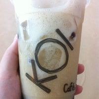 Photo taken at KOI Café by Cynthia L. on 3/18/2012
