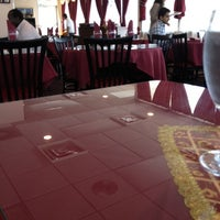 Photo taken at Moghul Fine Indian Cuisine by David O. on 7/26/2012