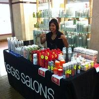 Photo taken at Regis Salon Pearlridge by Pearlridge C. on 4/13/2012