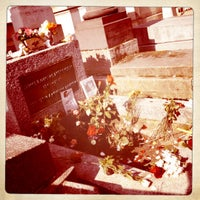 Photo taken at Tombe de Jim Morrison by Jessica M. on 3/14/2012