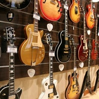 Photo taken at Cosmo Music - The Musical Instrument Superstore! by Christopher B. on 2/17/2012