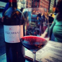 Photo taken at The Tangled Vine Wine Bar & Kitchen by Davaish S. on 5/2/2012