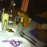 Photo taken at Bourbon Street Restaurant and Catering by Leslie G. on 5/28/2012