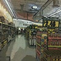 Photo taken at Food 4 Less by Robert M. on 5/13/2012