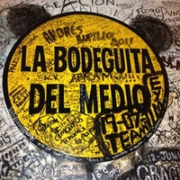 Photo taken at La Bodeguita del Medio by Bibiana O. on 8/4/2012