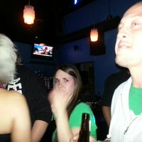 Photo taken at The Blue Bull Bar & Grill by Christina M. on 3/17/2013