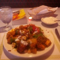 Photo taken at Taste of Tandoor Indian Cuisine by Emil F. on 3/2/2014