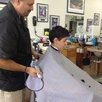 Photo taken at Tom & Jake's Barber Shop by Yvette M. on 3/22/2014