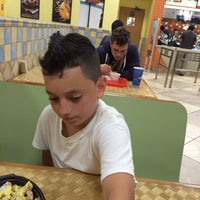 Photo taken at Pollo Tropical by Victor G. on 4/5/2014