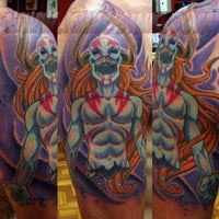 Photo taken at KHAOS INK TATTOO SHOP by Ariel S. on 3/11/2014