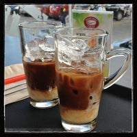 Photo taken at Highlands Coffee by Maricris E. on 7/18/2013