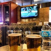 Photo taken at American Airlines Admirals Club by Chris H. on 11/25/2012