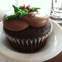 Photo taken at Indulgence Pastry Shop & Cafe by Erin S. on 12/27/2012