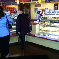 Photo taken at Indulgence Pastry Shop & Cafe by Erin S. on 3/29/2013