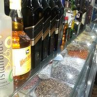 Photo taken at Büyük Tobacco Shop by Ahmet A. on 3/21/2015